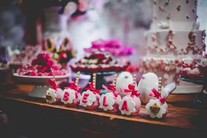 pink and white party favors on table with cake